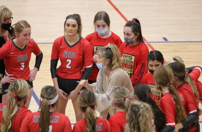 Holliday head coach Wendy Parker talks to the Lady Eagles during a timeout in the first set of their regional semifinal match with Brownfield on Tuesday, Nov. 10, in Tuscola.