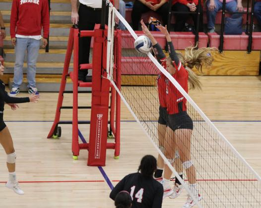Junior Payton Murray and sophomore Sydney Linn go up for a block in the first set of their regional semifinal match with Brownfield on Tuesday, Nov. 10, in Tuscola.