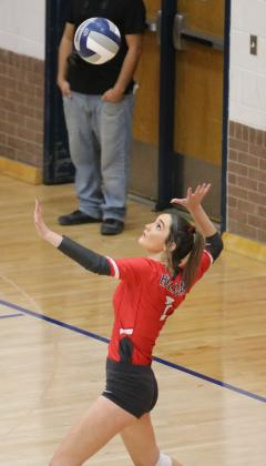 Sophomore Morgan Bodde serves up an ace in the second set of their regional semifinal match with Brownfield on Tuesday, Nov. 10, in Tuscola.