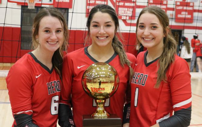 Seniors Avery Stone, Bree Zellers and Brittany James pose for a shot with the regional semifinal championship trophy following Holliday's 3-0 win over Brownfield on Tuesday, Nov. 10, in Tuscola.