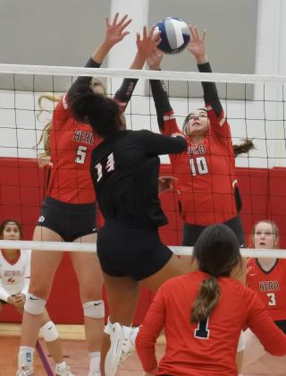 Senior Bree Zellers and junior Payton Murray reject a shot in the first set of their regional semifinal match with Brownfield on Tuesday, Nov. 10, in Tuscola.