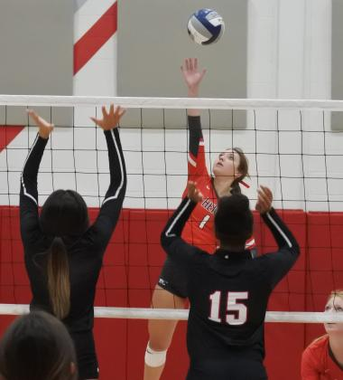 Senior Brittany James swings in the first set of their regional semifinal match with Brownfield on Tuesday, Nov. 10, in Tuscola.