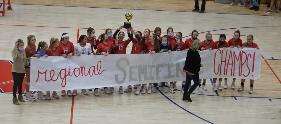 Holliday celebrates with the regional semifinals championship trophy and banner following Holliday's 3-0 win over Brownfield on Tuesday, Nov. 10, in Tuscola.