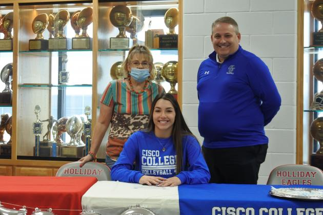 Holliday senior Bree Zellers, surrounded by friends and family, signed to play volleyball collegiately with Cisco College at the Holliday High School gym on Wednesday, Dec. 2.