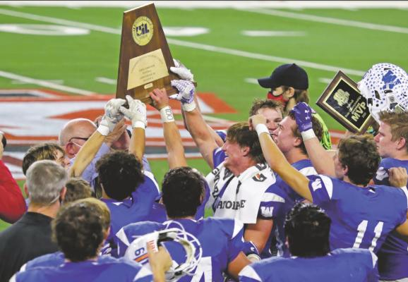 Trojans take home third football state championship in school history