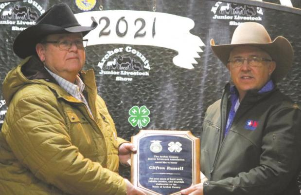 Mike Gilmore (right) presents a plaque to Clifton Russell for his service to the Archer County Junior Livestock Show. Photo/Jerry Phillips