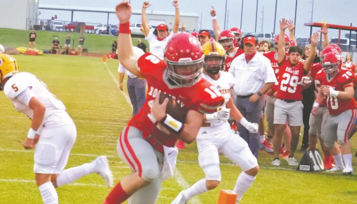 Holliday sophomore quarterback Peyton Marchand spins into the endzone in the first quarter of the Eagles' 34-21 homecoming win over Bells on Friday, Sept. 18. Photo/Will Edwards