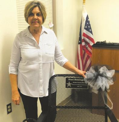 Archer County Sheriff Staci Williams Beesinger poses with a chair she was gifted at her retirement party Dec. 17. Beesinger's last day on the job is Thursday, Dec. 31, before Jack Curd takes over. Courtesy photo/P.A. Veith