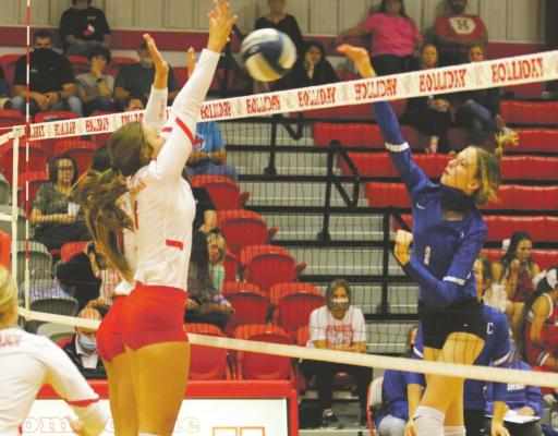 Seniors Brittany James and Bree Zellers go up for a block on their Senior Night win over Childress on Tuesday, Sept. 29. Courtesy photo/Jolene Styles