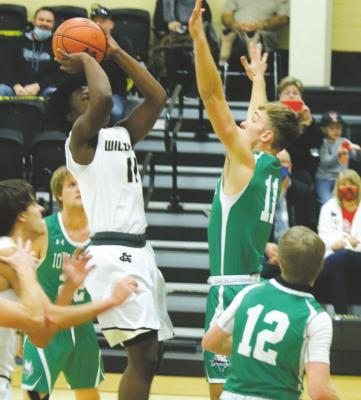 Freshman Elijah Jackson pulls up for a jumper in Archer City's 47-37 loss to Iowa Park on Saturday, Dec. 5. Photo/Jerry Phillips