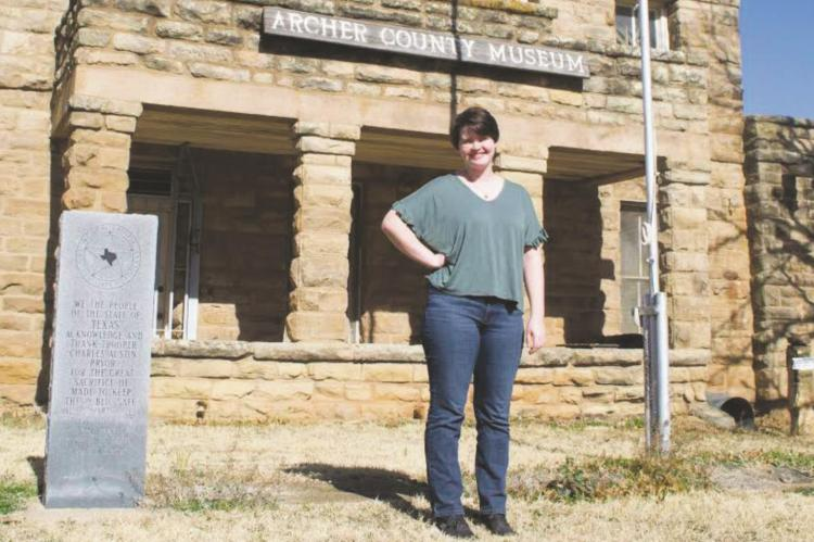 New Archer County Museum & Arts Center Project Director, Callie Lawson, poses in front of the ACMAC. The ACMAC is entering its assesment phase of the project. Photo/Nathan Lawson