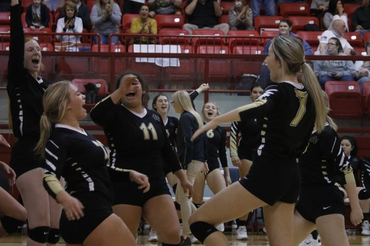 The Archer City Lady Cats celebrate a critical point in the win over Alvord on Thursday, Oct. 29, in Olney