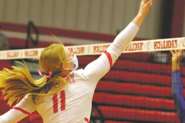 Holliday sophomore Campbell Jurecek swings over a pair of City View defenders in the Lady Eagles' 3-0 sweep of the Mustangs on Tuesday, Oct. 13. Courtesy photo/Jolene Styles