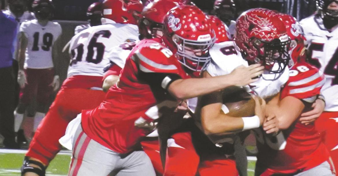 The Eagles defense swarms Eastland quarterback Behren Morton in the third quarter of Holliday's 28-24 loss to the Mavericks in the 3A-DII regional semifinals on Friday, Nov. 27, in Graham. Photo/Will Edwards