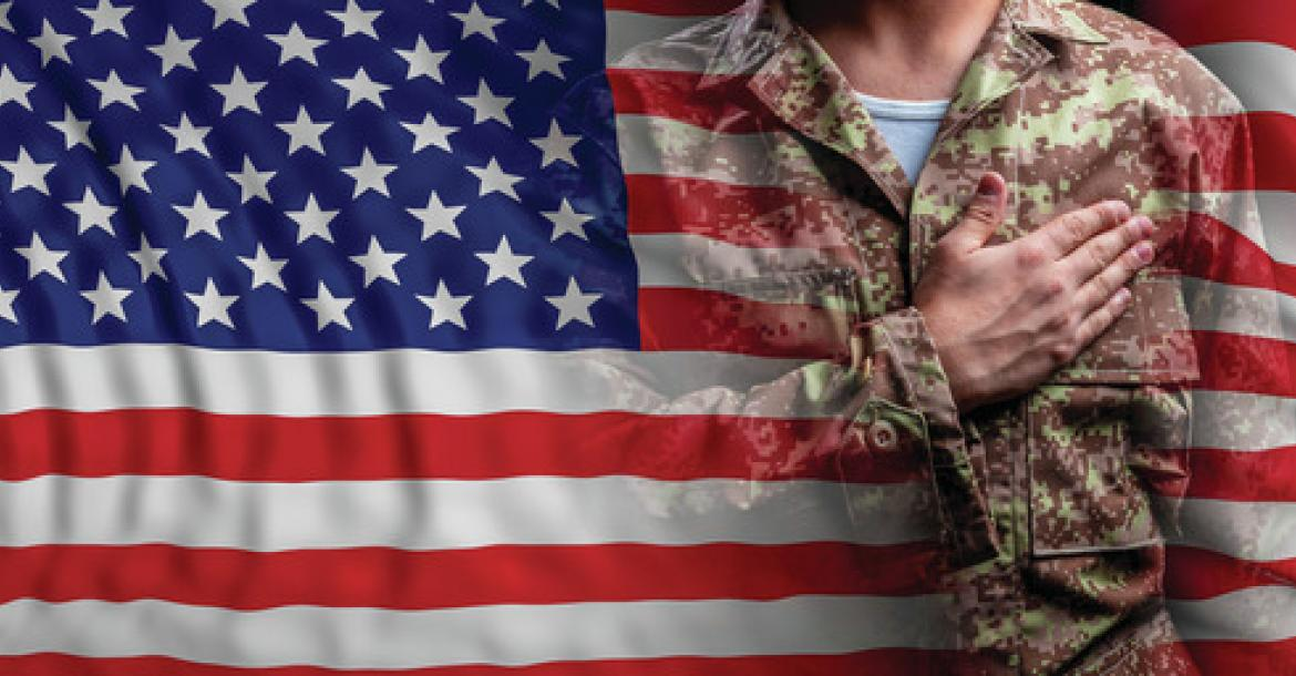 image of flag and soldier with hand on heart